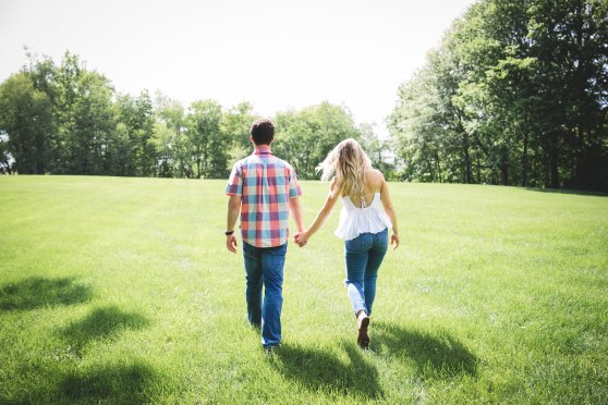 Couple walking across lawn.jpg