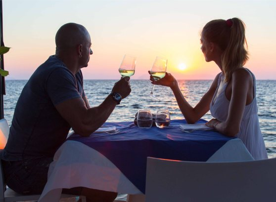 Couple on romantic date at sea restaurant